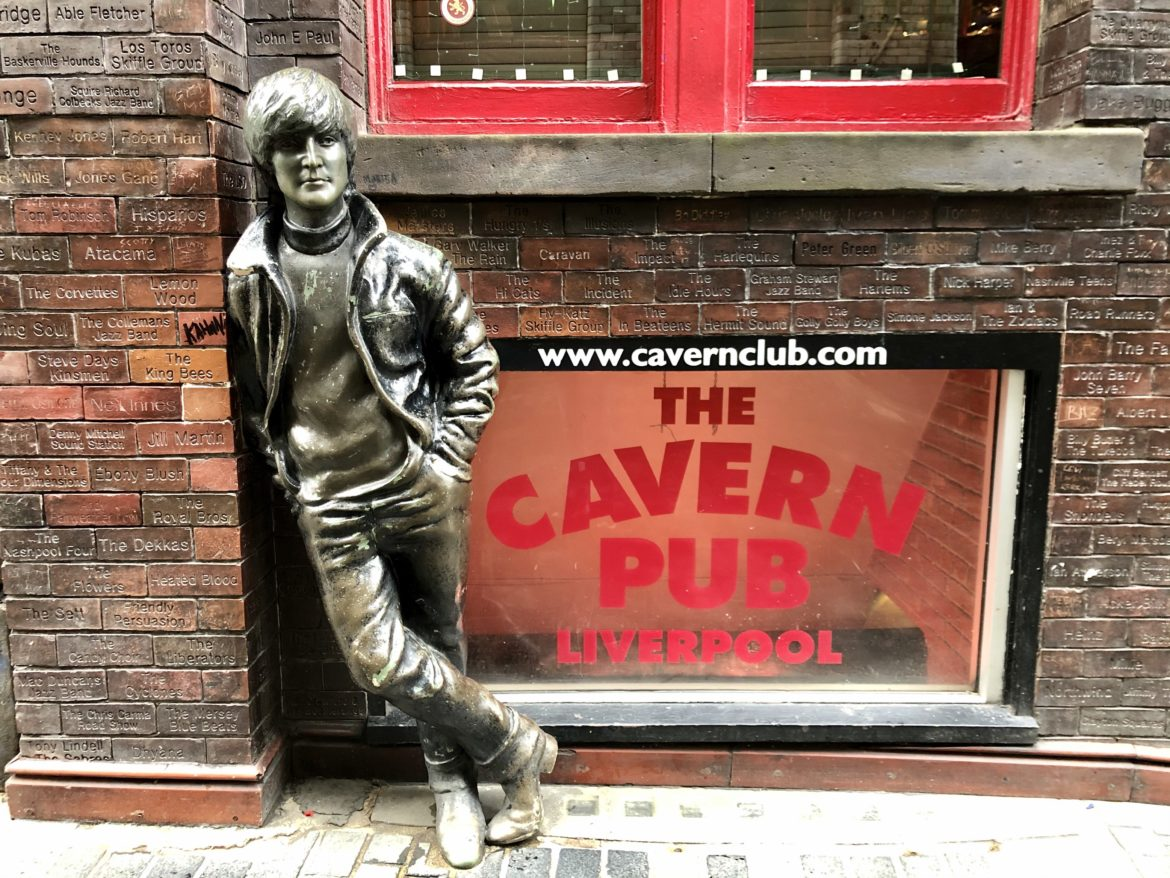 John Lennon statue in front of the Cavern Pub wall in Liverpool