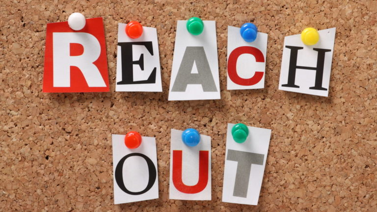 Bulletin Board with the words Reach Out in block letters