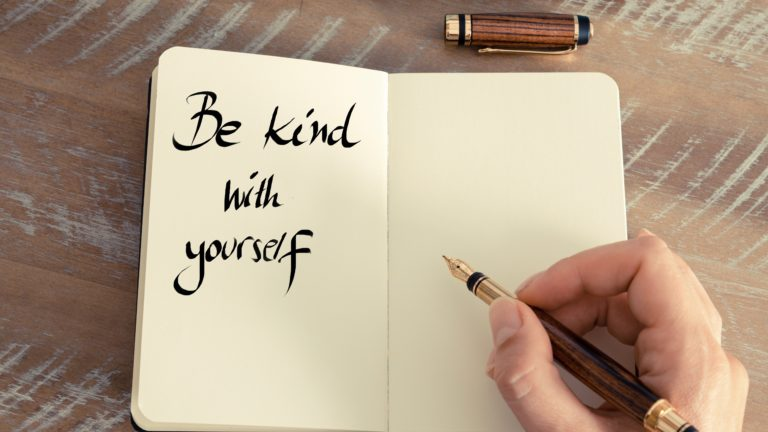 Handwritten text Be Kind With Yourself