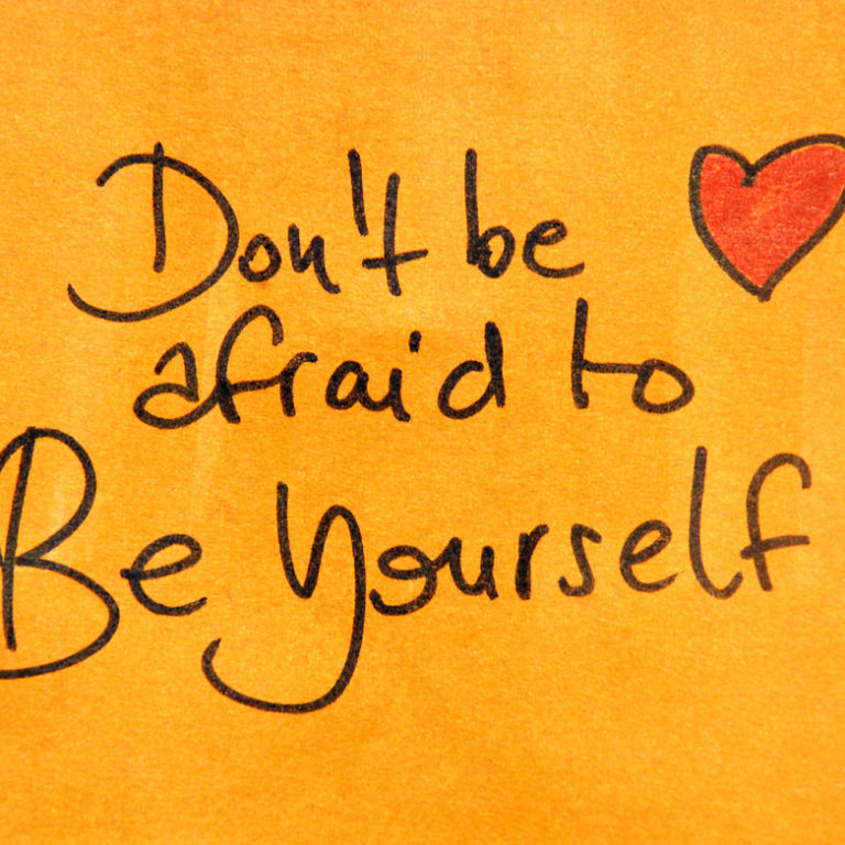Post it note with a heart and the words, Don't Be Afraid To Be Yourself